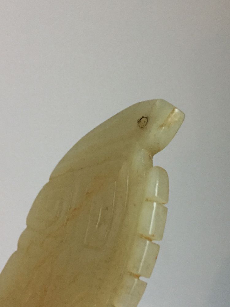 A rare Chinese yellow jade pendant, Western Zhou dynasty, carved as a stylised mythical beast with a - Image 2 of 11