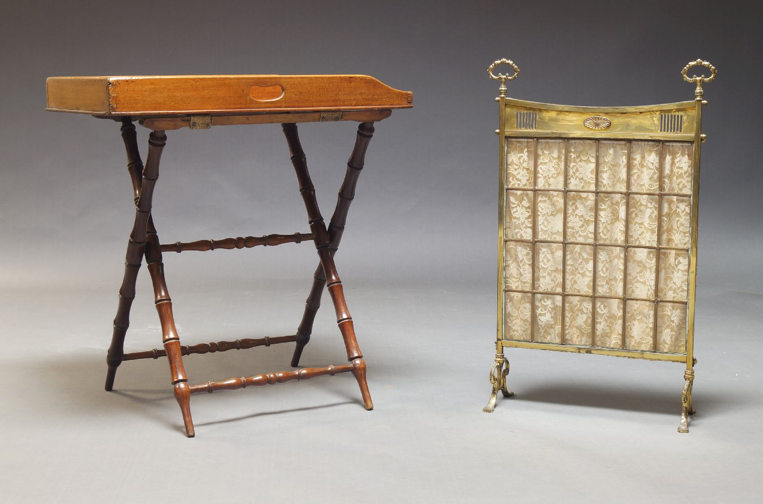 A mahogany butlers tray, 19th Century, the rectangular tray with pierced handles, on folding