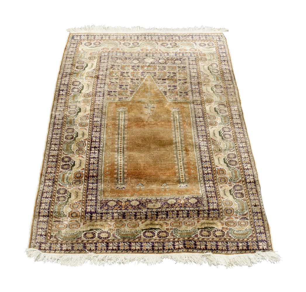 A West Persian silk prayer rug, mid to late 20th century, with Mihrab field, enclosed by ivory