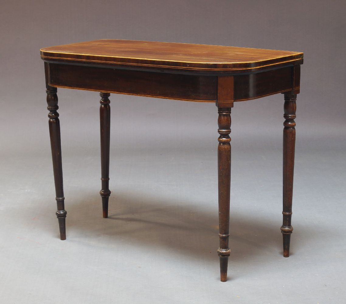 A mahogany and boxwood strung card table, 19th Century, the fold over top enclosing green baize