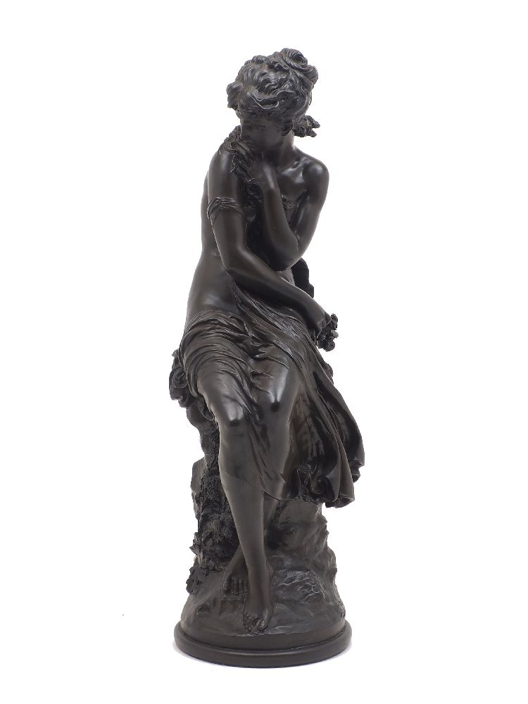 A composite bronzed figure of Venus, after Moreau, late 20th century, modelled seated on a rock