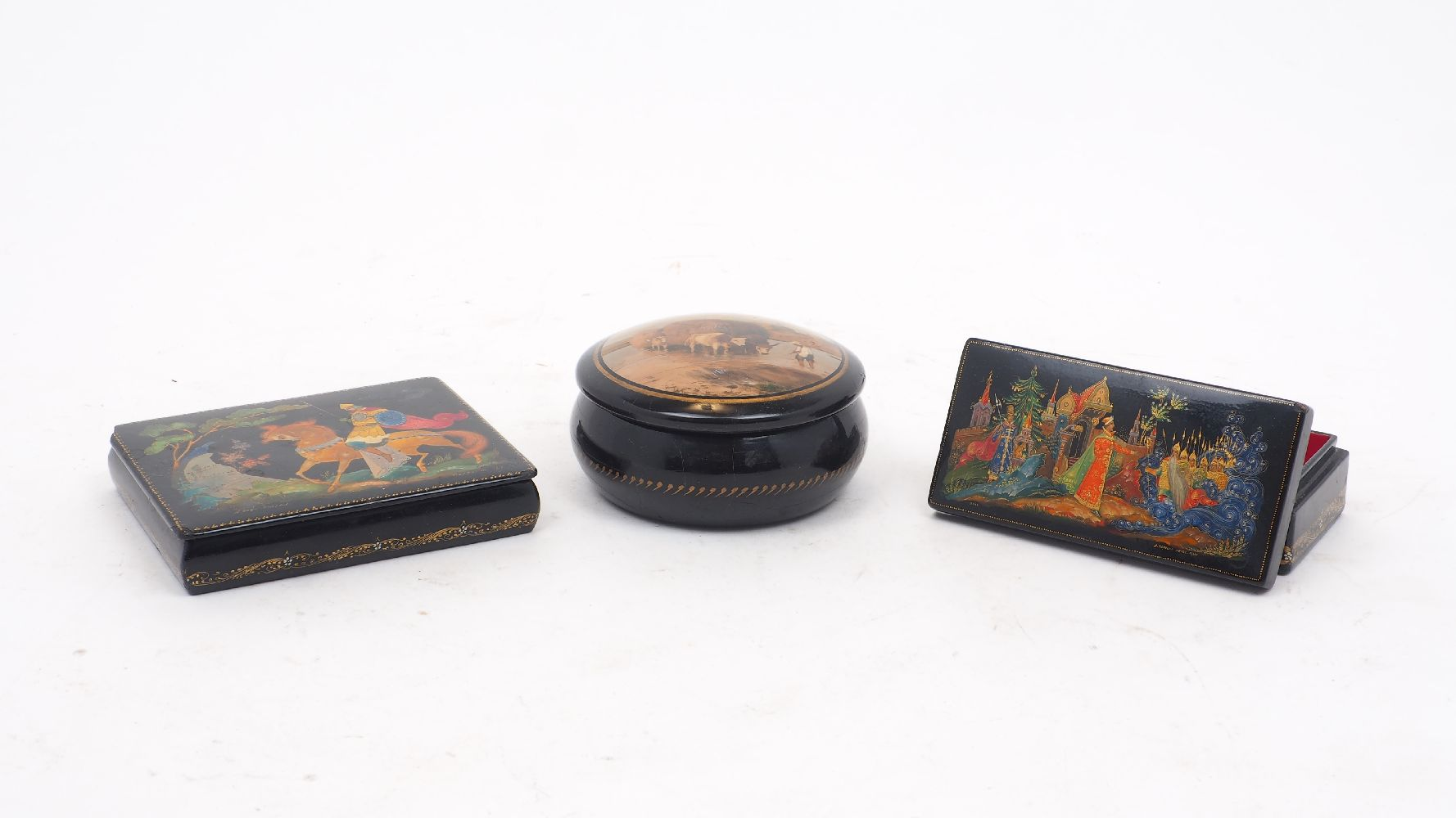 Three Russian Palekh lacquer boxes, 20th century, comprising: a hinged example decorated with a