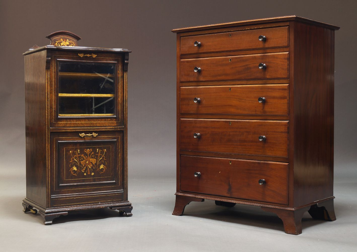 An Edwardian faux rosewood and inlaid music cabinet, with glazed fall front door enclosing three