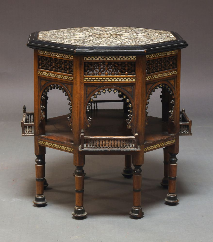 A Middle Eastern mother of pearl inlaid occasional table, the octagonal top with geometric pattern