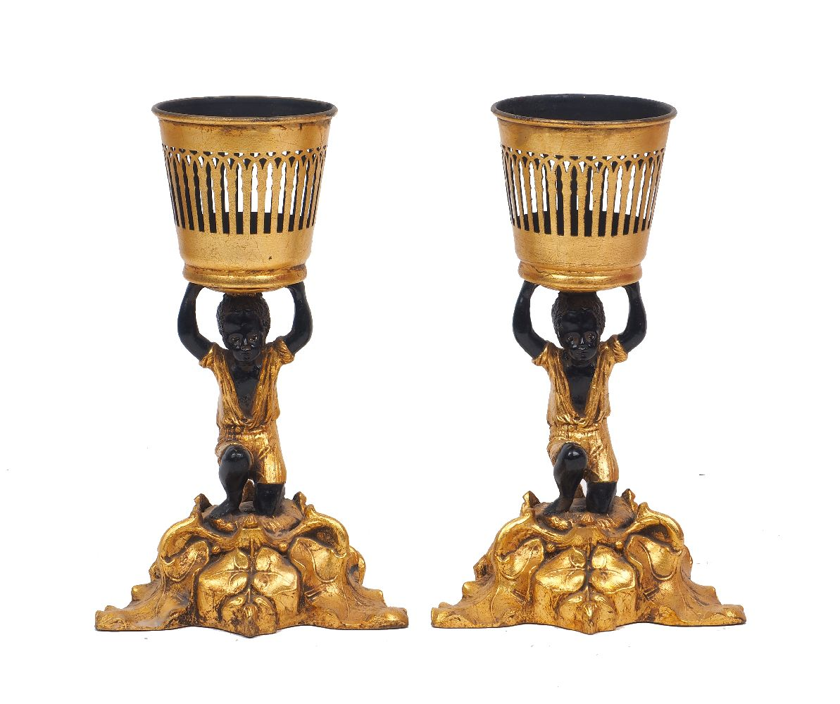 Two figural gilt resin candle holders, late 20th century, each modelled as a crouching boy, on