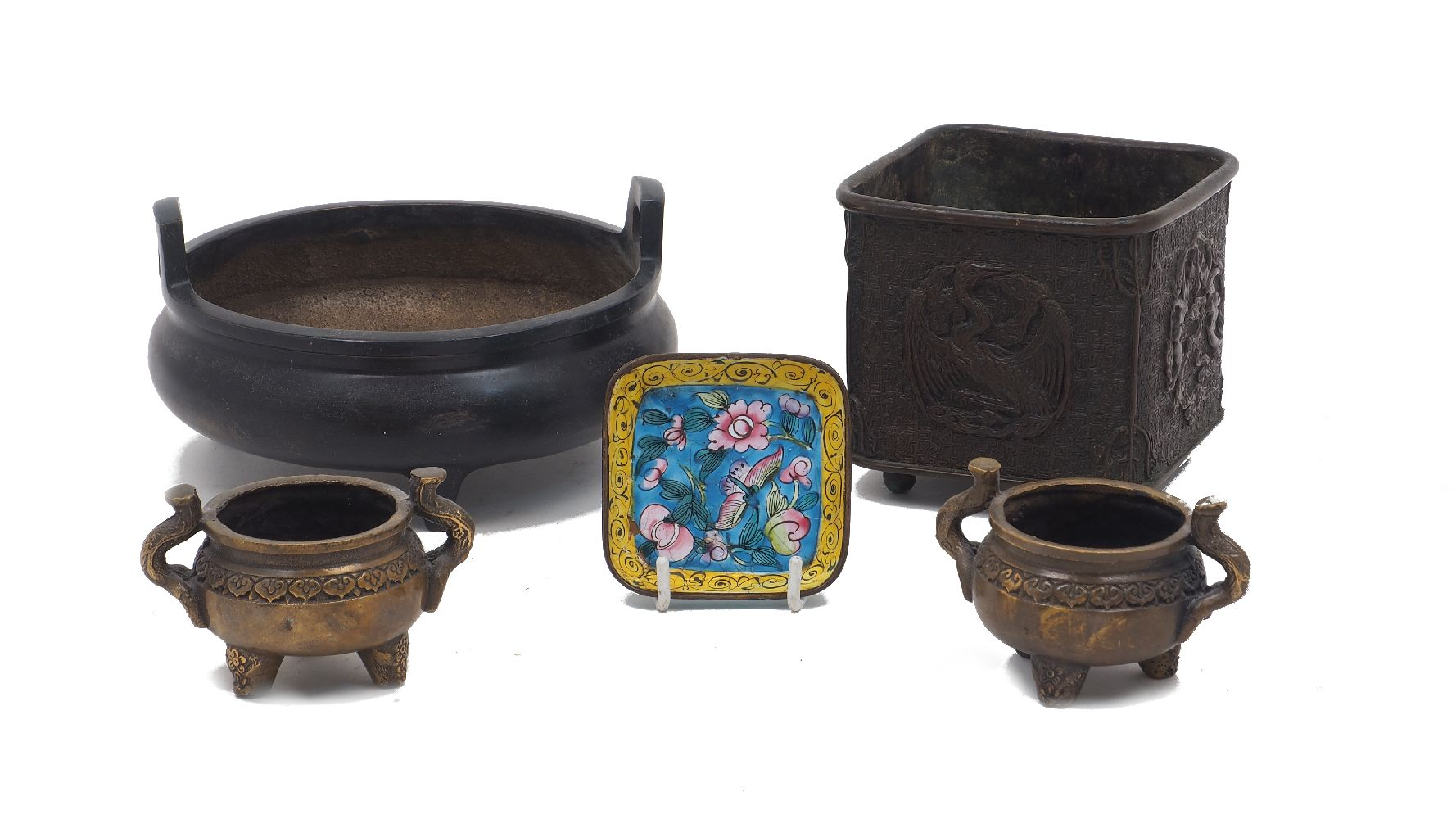 A Chinese low twin handled bronze censer, raised on tripod feet, gilt character mark to the