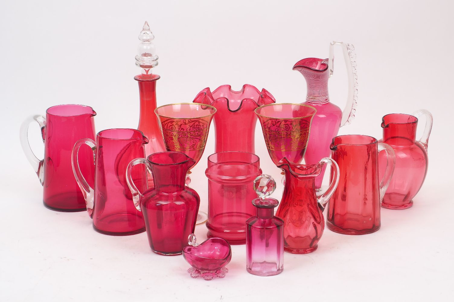 Fourteen pieces of Victorian and later cranberry glass, to include two goblets with gold