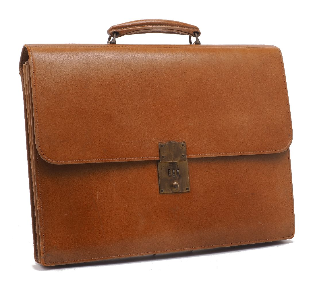 A Fortnum & Mason orange leather briefcase, mid 20th Century, outfitted with a gilt metal clasp