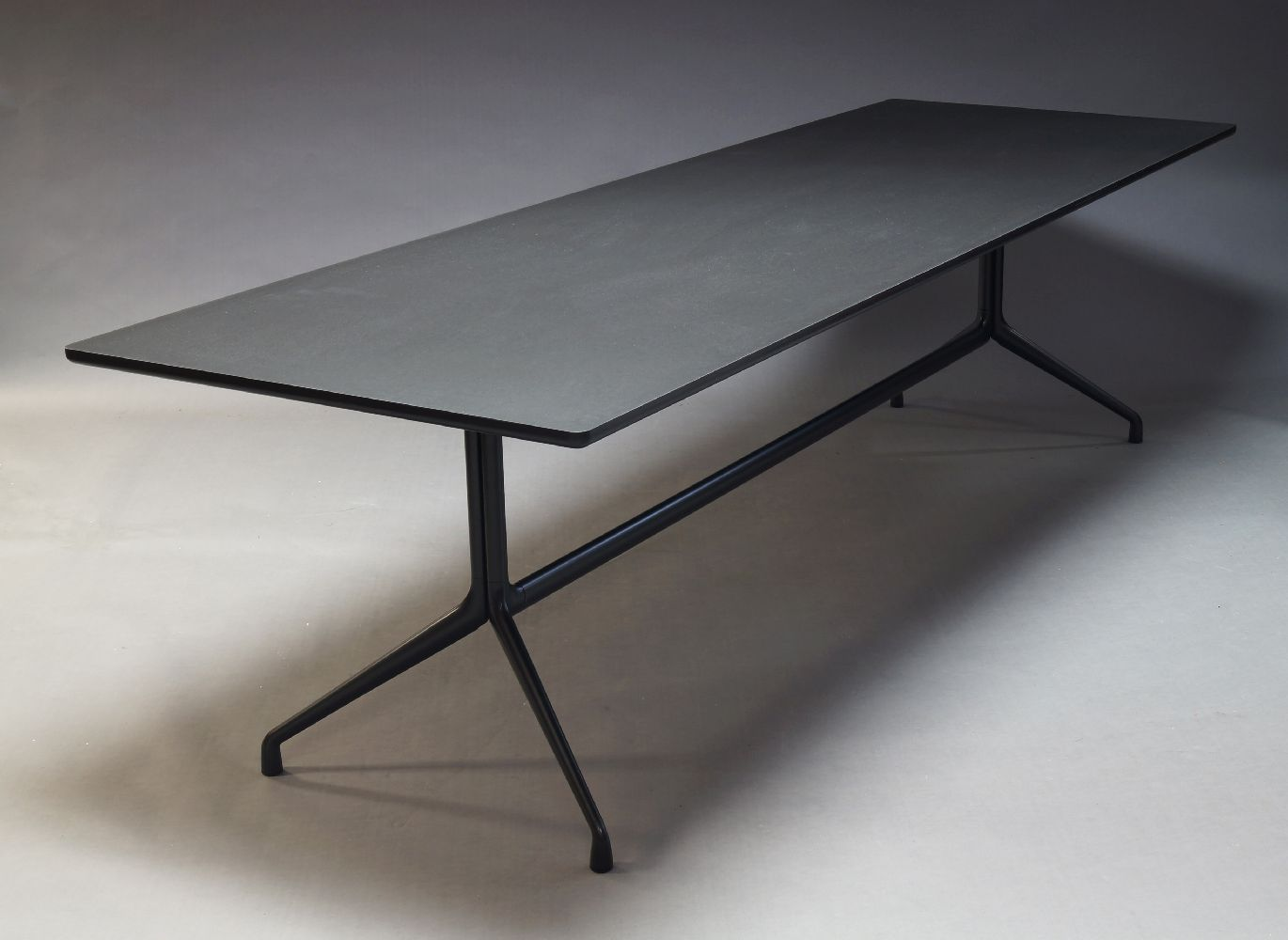Hay, an AAT 10 dining table, of recent manufacture, the black finished rectangular top on black