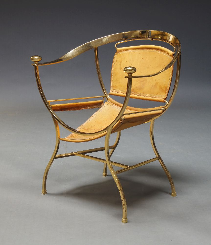 A gilt metal classical taste armchair, late 20th Century, with tan leather seat on curved backrest