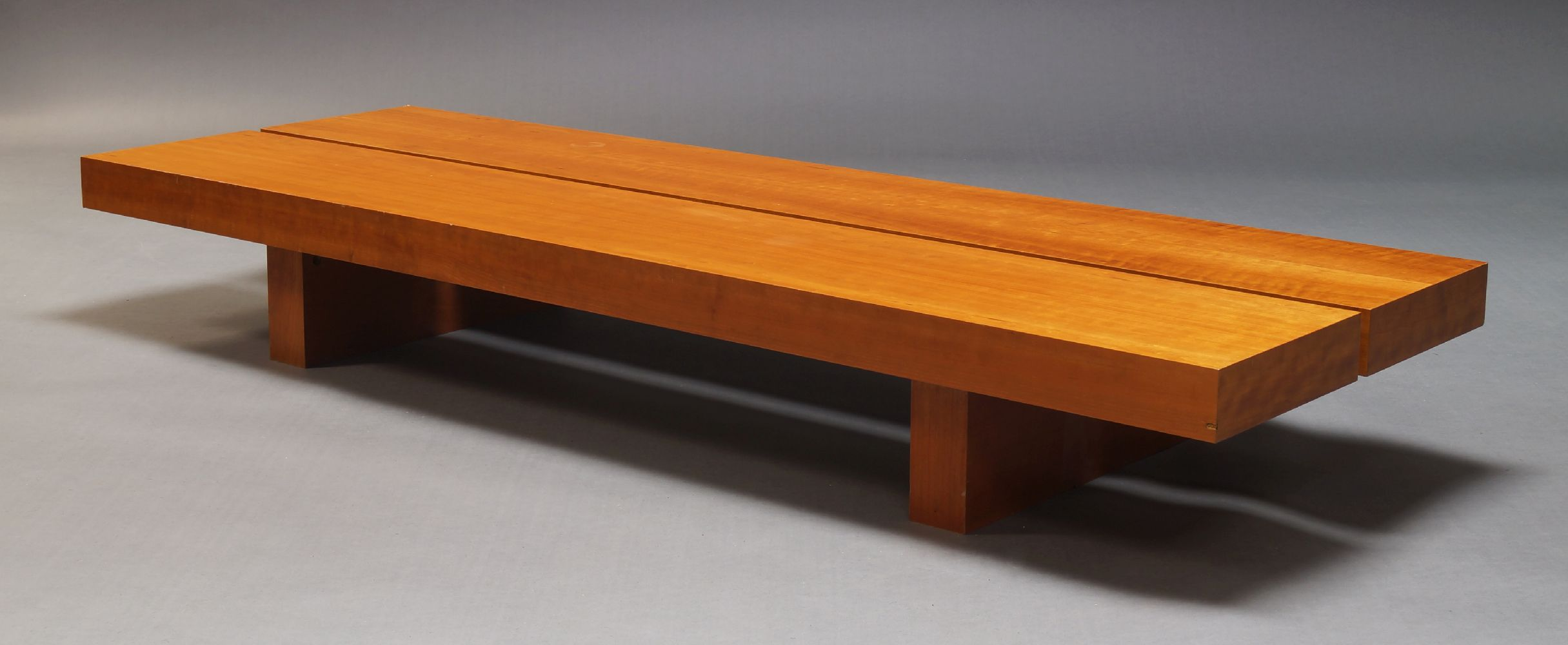 A contemporary cherry wood veneered low coffee table, of recent manufacture, with rectangular two