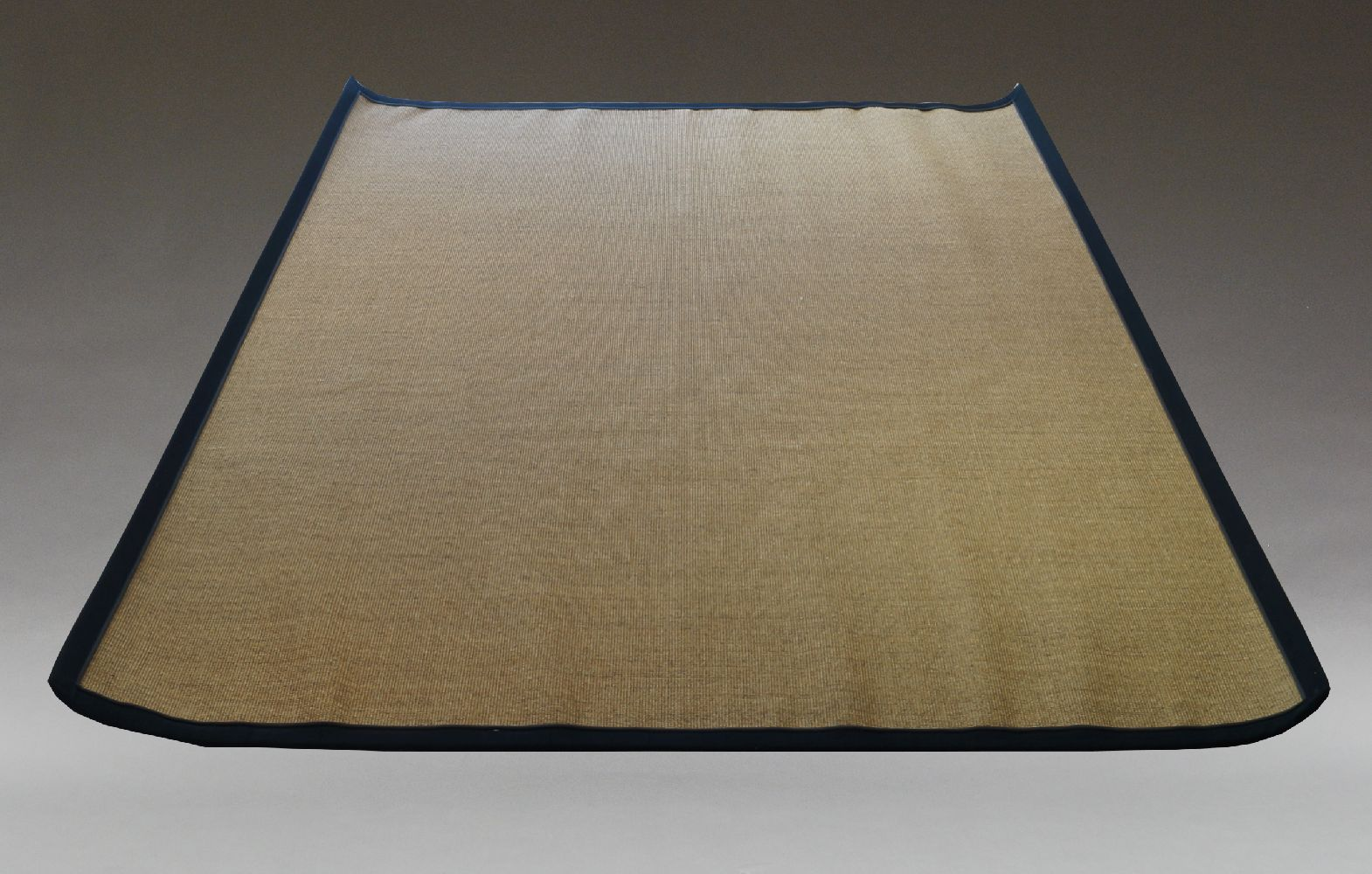 A contemporary Jute rug, of recent manufacture, with black fabric border, 320cm x 250cmPlease