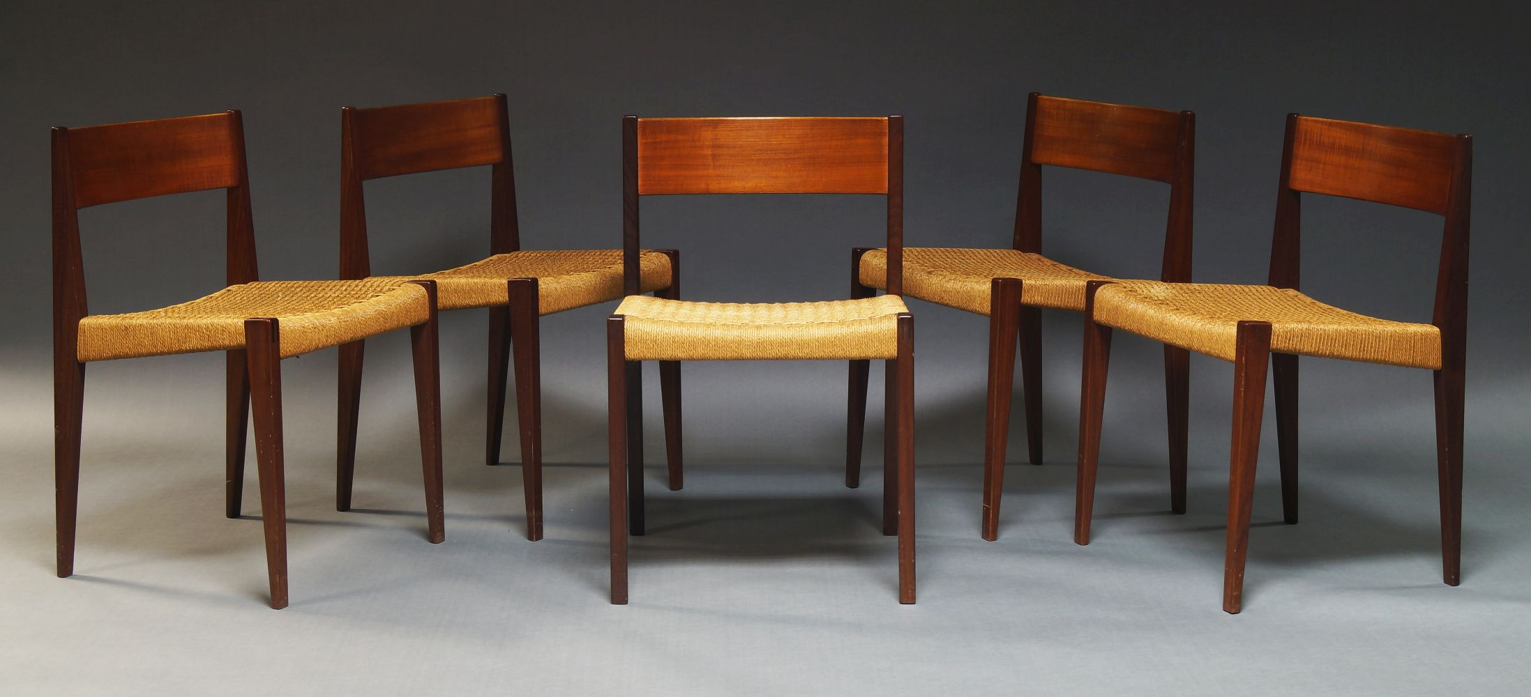 A set of five Danish teak dining chairs, c.1960 with curved backrests and woven cord seats on