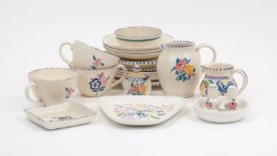 A Poole pottery part tea service, early to mid 20th century, decorated with various abstract flora