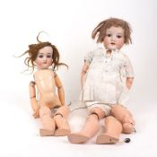 An Armand Marseille 390 bisque headed doll, early 20th Century, with weighted brown glass eyes, open