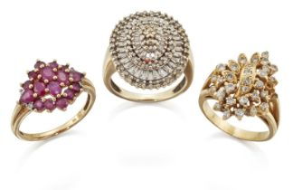 Two diamond rings and a ruby ring, the first a brilliant-cut diamond floral cluster ring, ring