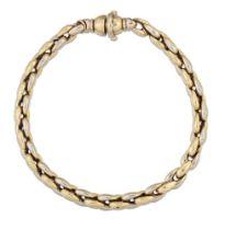 An 18ct two colour gold bracelet, of fancy belcher link design, clasp defective, London hallmarks,