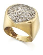 A diamond ring, of oval pave cluster design, with stylised bi-foliate collet setting, to a