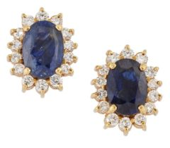 A pair of sapphire and diamond cluster earstuds, each claw-set oval sapphire with brilliant-cut