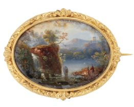 A 19th century gilt mounted painted miniature brooch, depicting a lake scene, c.1840Please refer