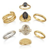 Eight various gold and gem rings, comprising: a claw-set oval sapphire ring of crossover design with