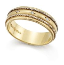 An 18ct two colour gold diamond band ring, the textured band with white gold ropework detail and set