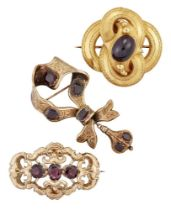 Three Victorian gold and garnet brooches, comprising: one of looped quatrefoil design with central