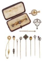 Eight various stickpins and four brooches, stickpins include an Art Nouveau diamond and ruby two