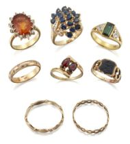 A group of eight rings, comprising: an oval sapphire spray with brilliant-cut diamond stem; a