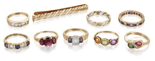 Eight various 9ct gold and gem synthetic gem rings and a 9ct gold tie slide, rings include: a 9ct