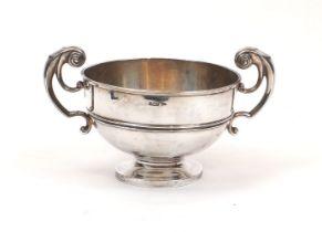 An Edwardian silver Walker & Hall centrepiece bowl, Sheffield, c.1902, the circular body raised on a