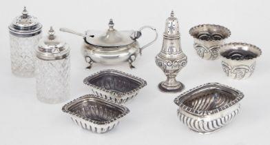 A three-piece silver cruet set, London, c.1901, Josiah Williams & Co, the two circular salts and