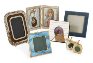 A blue enamel and gilt metal photo frame, together with a further five variously designed photo