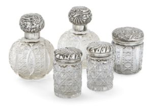 Five silver mounted glass vanity vessels, including: a pair of globular cut glass examples,