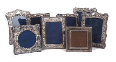 Eight silver mounted photo frames including a shaped square example, Sheffield, c.1992, Carr's of
