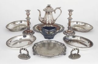 A small quantity of silver plate comprising: a pair of entrée dishes; a bread board with wooden