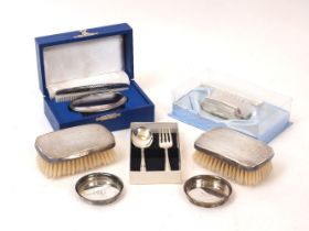 A pair of silver backed brushes, London, c.1974, TP, the engine turned backs with presentation
