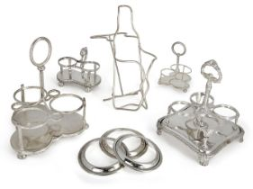 A silver plated wine bottle coaster, together with a collection of silver plated cruet stands,