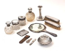A group of silver items comprising: a Victorian silver bonbon dish designed as a scallop shell,