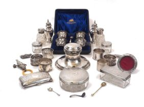 A group of silver comprising: a cased set of four silver salt cellars and two salt spoons, London,