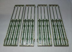 A four sectioned metal gate, early 20th Century, with vertical decorative posts, each section