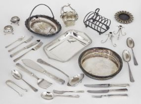 A group of silver plate including: a toast rack; a pair of small candlesticks raised on c-scroll