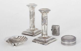 A pair of Edwardian silver candlesticks, Birmingham, c.1908, Henry Matthews, of short columnar form,