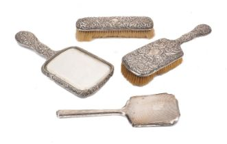 Two Victorian silver backed brushes and a hand mirror, Birmingham, c.1896 and 1897, Henry