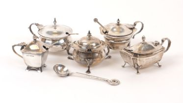 Five Edwardian and later silver mustards, and several condiment spoons, the mustards including one