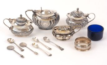 Four silver mustards, together with five various silver condiment spoons and a silver napkin ring,