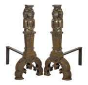 A pair of large cast iron fire dogs, 17th century style, the uprights each cast with a figural