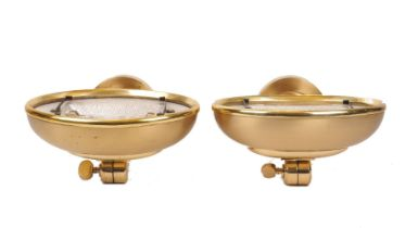 A set of five brass uplighter wall lights, of recent manufacture, with adjustable domed shades on