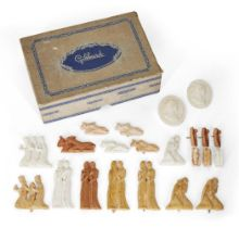 A collection of modern miniature plaster figurines, depicting various animals and characters from