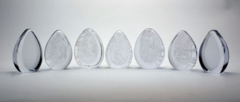 A collection of Wedgwood and other unmarked English clear glass paperweights, 20th Century, to